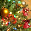 Christmas fir tree with colorful lights close up — Stok fotoğraf