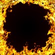 The close-up of yellow fire and dark as a background — Stock Photo