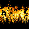 The close-up of yellow fire and dark as a backgroun — Stock Photo