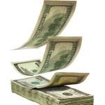 Falling dollars to stack — Stock Photo