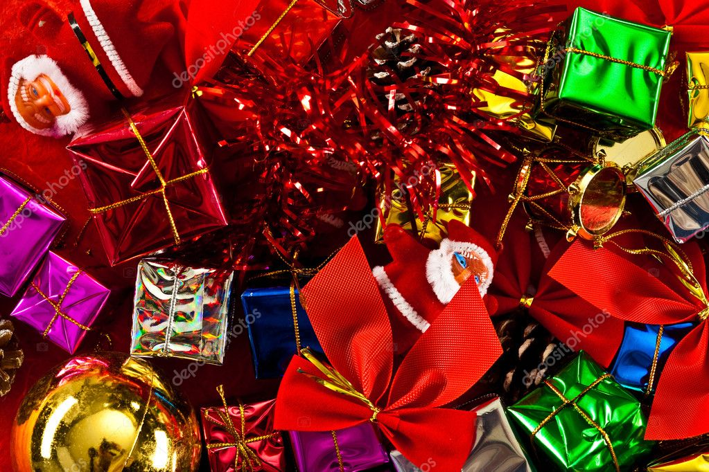 Red, Green, Gold, and Silver Wrapped Holiday Christmas Gifts on paper — Stock Photo #9604725