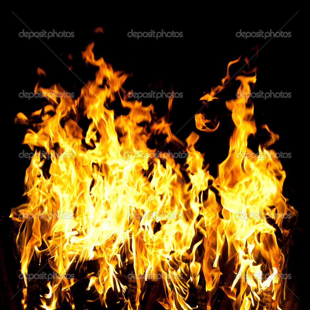 The close-up of yellow fire and dark as a backgroun — Stock Photo #9605920