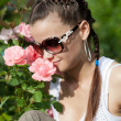 Stockfoto: Beautiful girl sniffs scent of roses