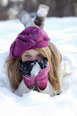 Smiling Woman Lying in the Snow — Stock Photo