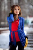 Portrait of a girl in the mittens on the street — Stock Photo