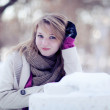 Snow Portrait of a beautiful girl. The girl was leaning on the a — Stock Photo