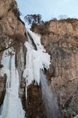 Falls in the snow in the autumn. Kegety canyon in Asia, Kyrgyzst — Stock Photo