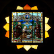 Stained glass window in St.Vitus cathedral - Stock Photo