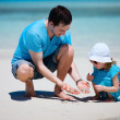 Stock Photo: Father and daughter at beach