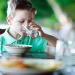 Little boy drinking water — Stock Photo