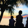 Silhouettes of mother and two kids — Stock Photo
