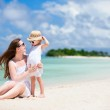 Mother and daughter at tropical beach — Stock Photo #10146562