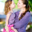 Mother and daughter outdoors — Stock Photo #10557259