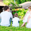 Family outdoors on summer day - Stock Photo