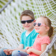 Royalty-Free Stock Photo: Kids sitting in hammock