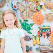 Stock Photo: Little girl at crafts market
