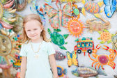 Little girl at crafts market — Stock Photo