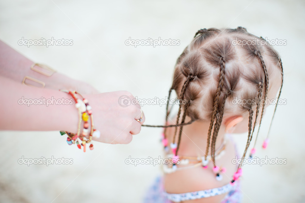 Close up of mother making Caribbean braids to her little daughter — Stock Photo #10557755
