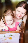 Mother and daughter painting a batik — Stock Photo