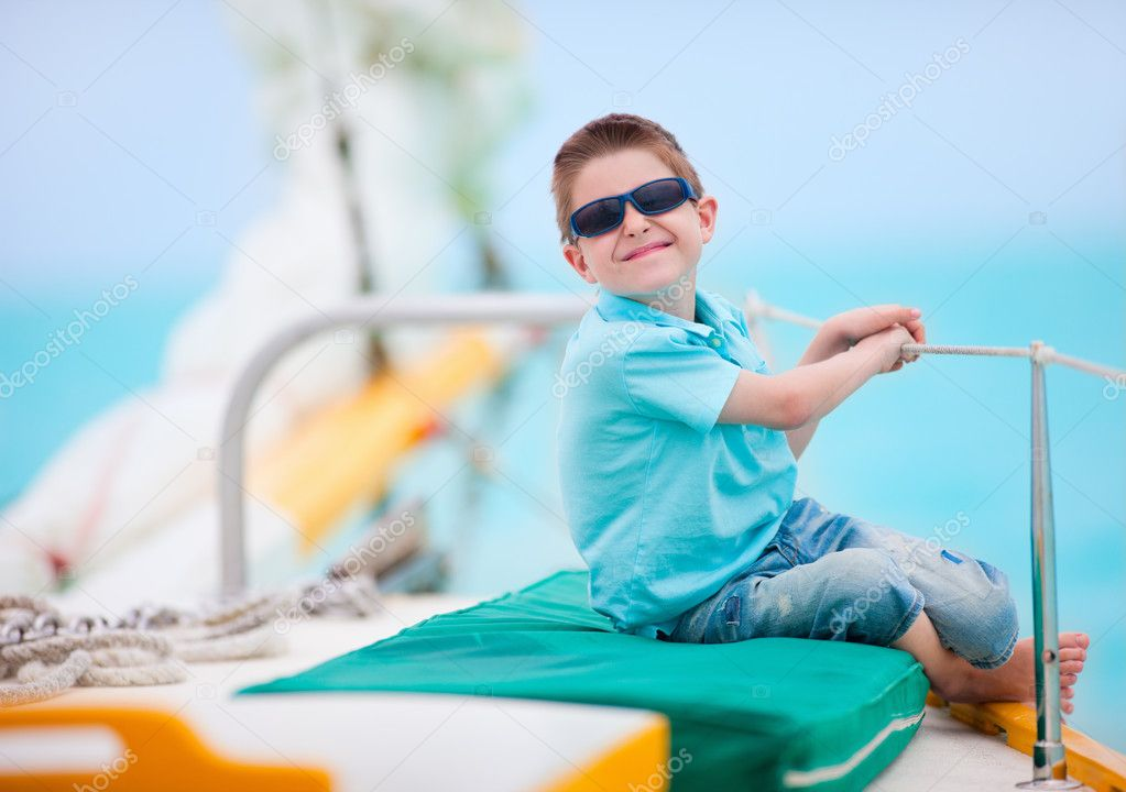 Portrait of cute little boy sailing on luxury yacht  Stock Photo #10615246