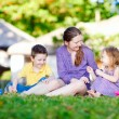 Mother and kids outdoors — Stock Photo