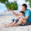 Royalty-Free Stock Photo: Father and son at beach