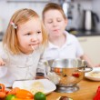 Two kids eating spaghetti — Stock Photo