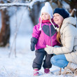Mother and daughter outdoors at winter — Stock Photo #8522317