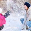 Mother and daughter outdoors at winter — Stock Photo #8855289