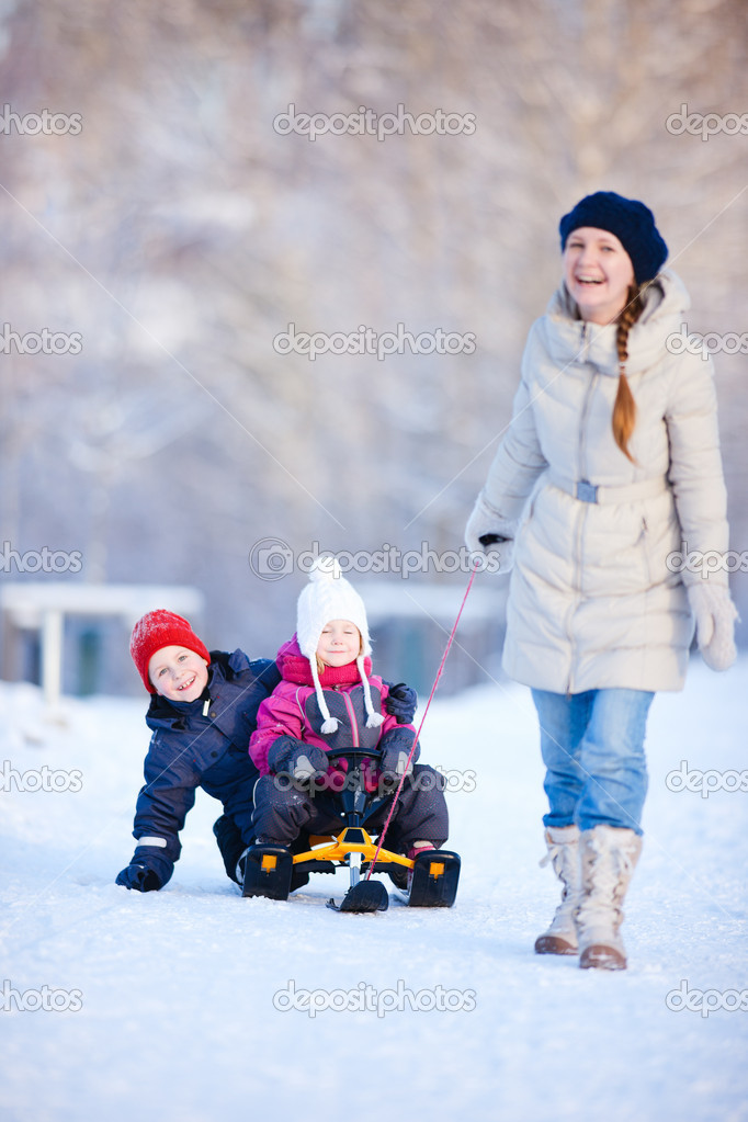 Mother and two kids outdoors on beautiful winter day. Focus on kids — Stock Photo #8855188