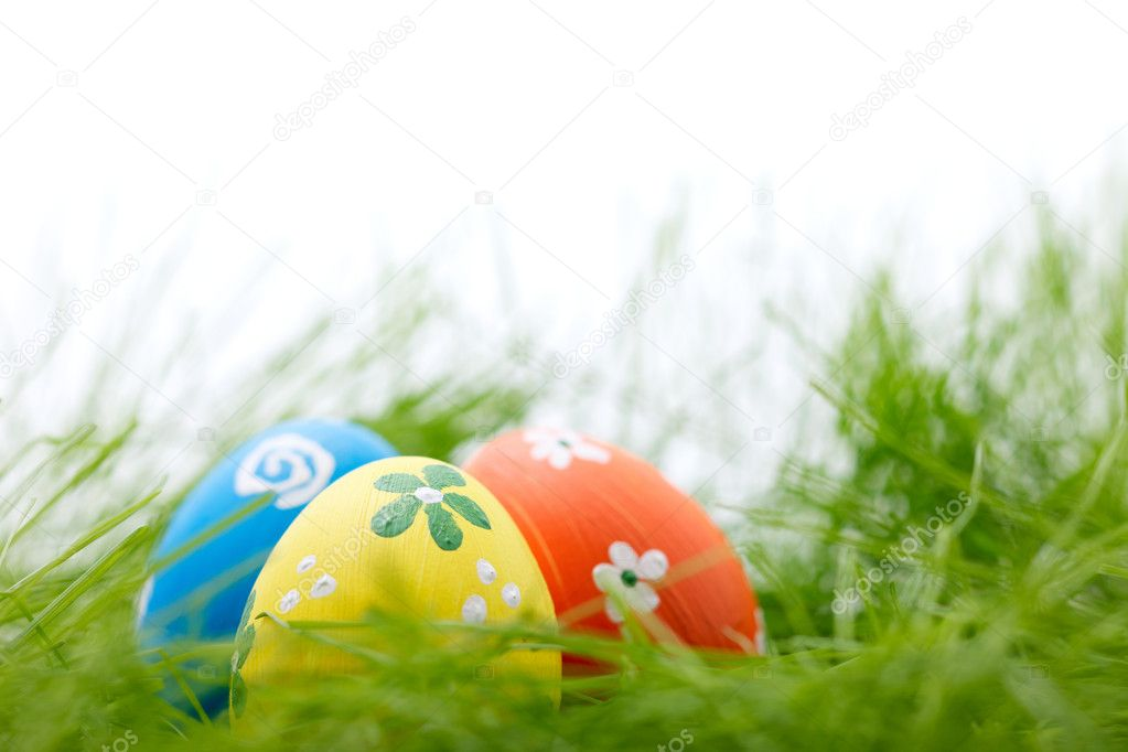 Three colorful easter eggs in a fresh grass — Stock Photo #9027423
