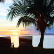 Sunset at tropical resort — Stock Photo
