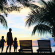 Stock Photo: Silhouettes of mother and two kids