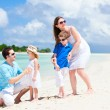 Happy family on tropical vacation — Stock Photo #9649606