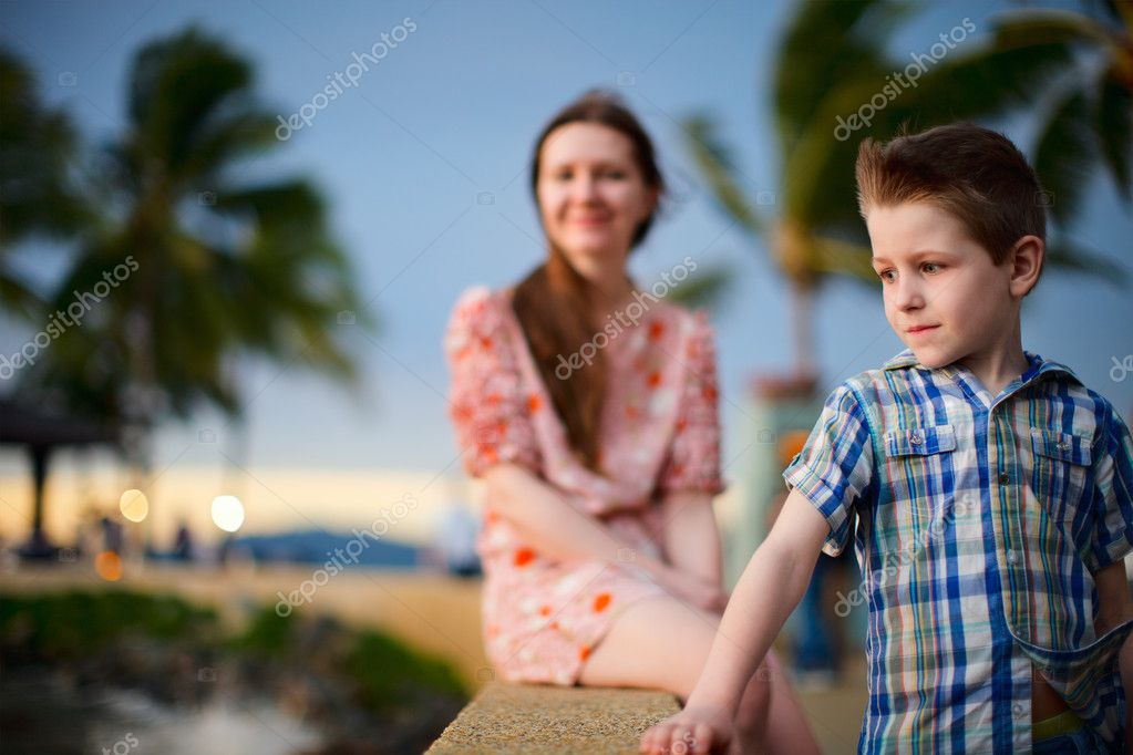 Portrait of cute boy and his mother enjoying sunset  Stock Photo #9649361