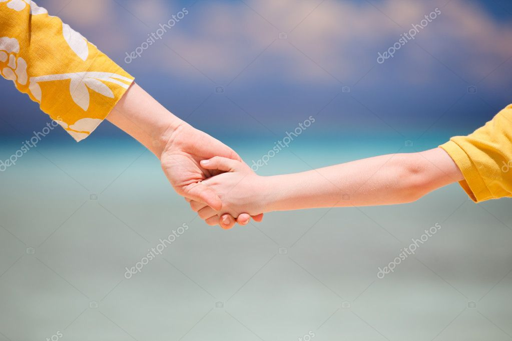 Close up of mother holding her son hand — Stock Photo #9649740