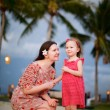 Mother and daughter enjoying sunset — Stock Photo