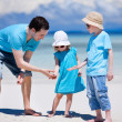 Father and kids at beach — Stock Photo #9785683