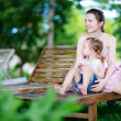 Mother and daughter outdoors - Stockfoto