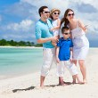 Happy family on tropical vacation - Stock Photo