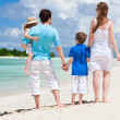 Happy family on tropical vacation — Stock Photo