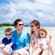 Happy family on tropical beach — Stock Photo