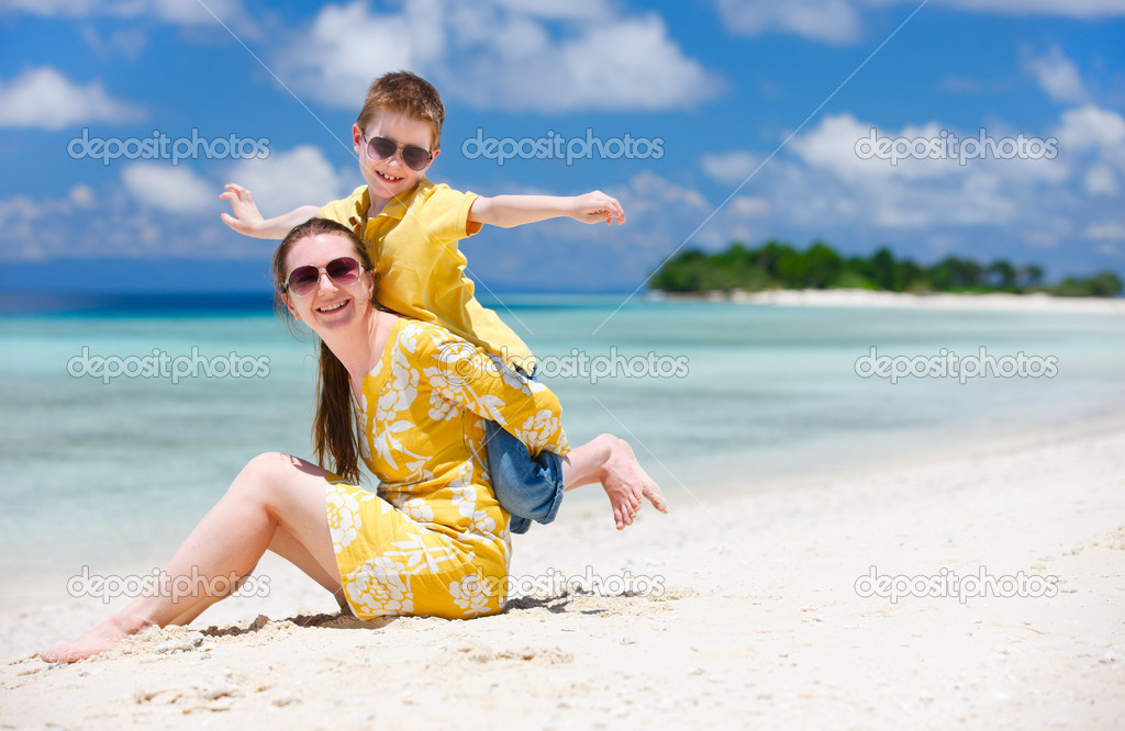 Happy beautiful mother and son enjoying beach time — Stock Photo #9813684