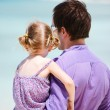 Father and daughter looking at ocean — Stock Photo #9921262