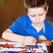 Boy drawing - Stock Photo