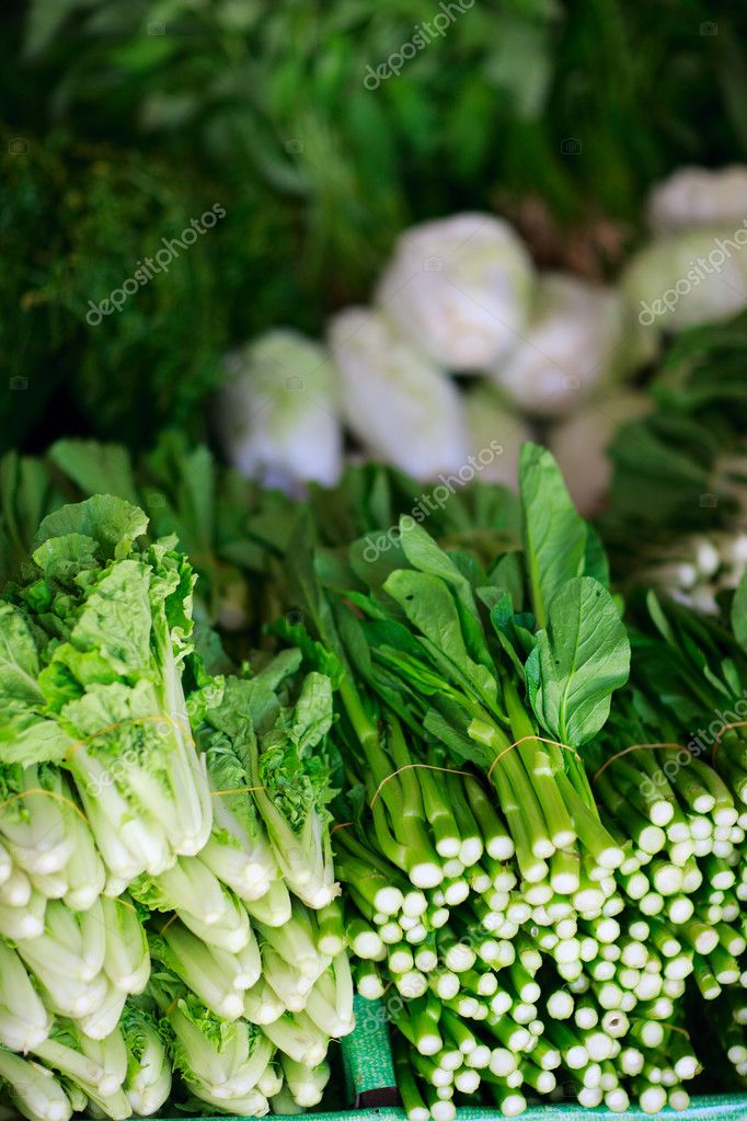 Variety of fresh green herbs at market — Stock Photo #9922413
