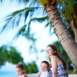 Family enjoying evening at beach — Stock Photo #9990561