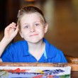 Boy painting a batik — Stock Photo #9990823