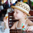 Little girl eating cookie — Stock Photo #9990900
