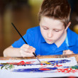 Stock Photo: Boy painting batik